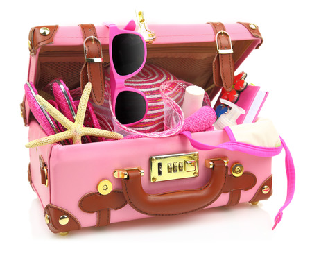 stuff: Ready to travel pink suitcase with summer equipment isolated Stock Photo