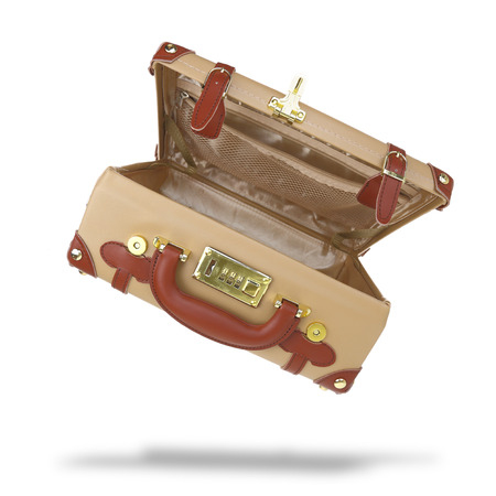 Open empty brown suitcase isolated on white photo