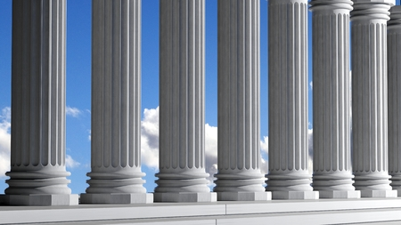 Ancient marble pillars in a row with blue sky photo
