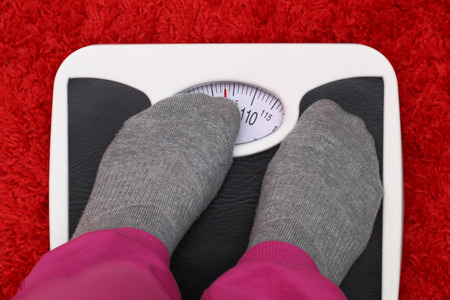Female feet on bathroom scale photo