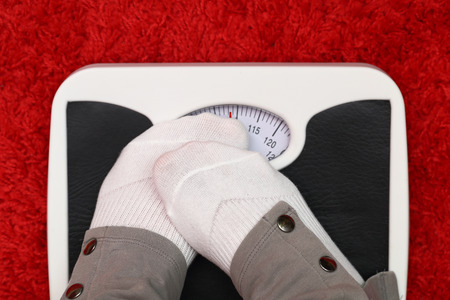 anorexia: Female feet on bathroom scale
