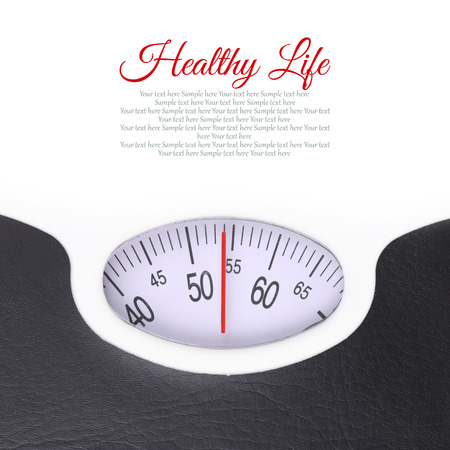 dietician: Close up of bathroom scale on white background Stock Photo