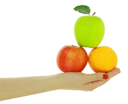 nutritionist: Female hand with fresh colorful fruits isolated on white