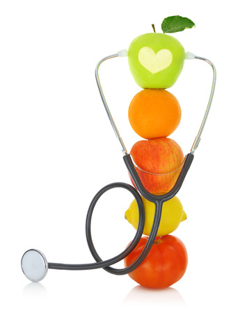 cure prevention: Stethoscope with fresh fruits isolated on white  Stock Photo