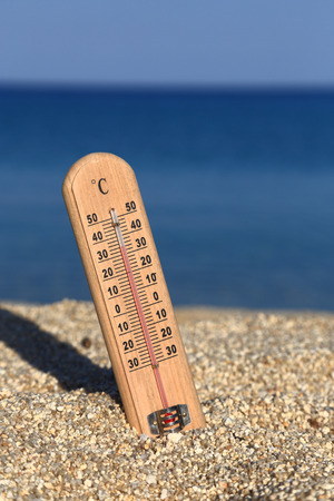 Thermometer on a beach shows high temperatures Stock Photo - 28871893