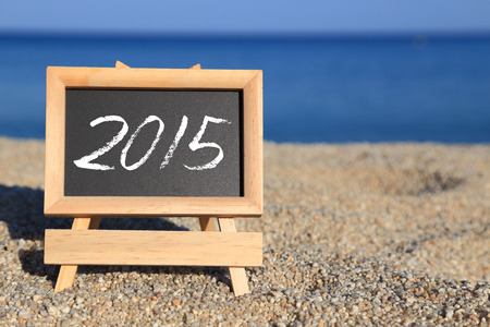 Blackboard with 2015 text on the beach  photo