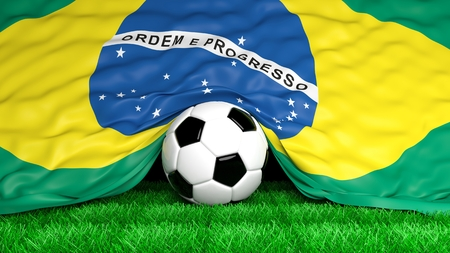 Soccer ball with Brazilian flag on football field closeup  photo