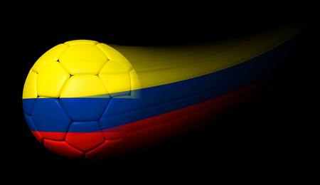 Soccer ball with Colombian flag in motion on black photo
