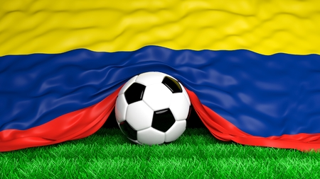 Soccer ball with Colombian flag on football field closeup photo