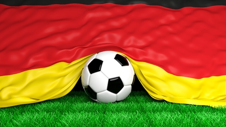 Soccer ball with German flag on football field closeup photo