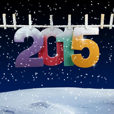 wesolych swiat: Liczba 2015 na clothesline na tle zimowej nocy Zdjęcie Seryjne