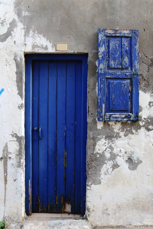 Weathered door in the old town of Chania, Crete island photo