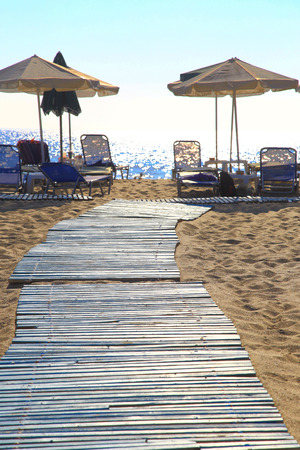 loungers: Sandy beach with parasols and beach loungers Falasarna Crete