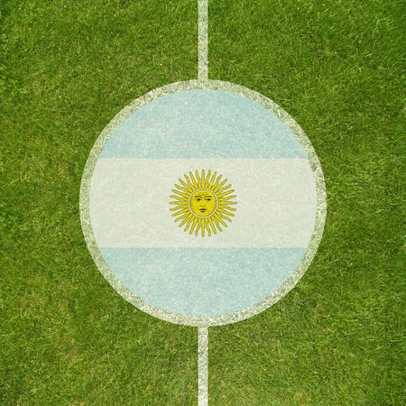 argentinian flag: Football field center closeup with Argentinian flag in circle