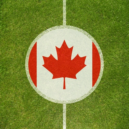 canadian football: Football field center closeup with Canadian flag in circle  Stock Photo