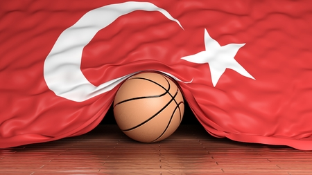 Basketball ball with flag of Turkey on parquet floor photo