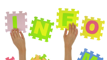 Hands forming word info with jigsaw puzzle pieces isolated photo