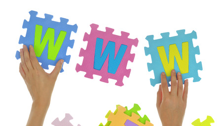 Hands forming word www with jigsaw puzzle pieces isolated Stock Photo