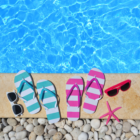 agencies: Flip flops, glasses and starfish by the poolside
