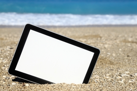 Tablet computer on the beach photo