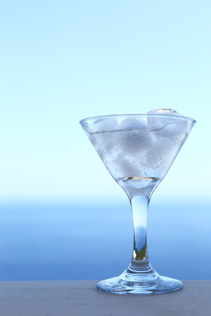 gin: Cold transparent cocktail in glass with ice cubes Stock Photo