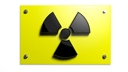 Nuclear warning sign isolated on white background  photo