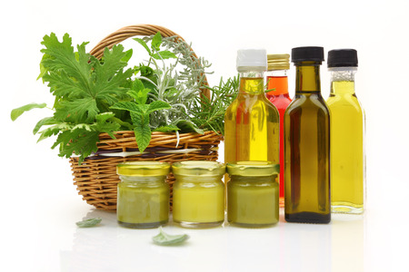 balm: Fresh herbs in wicker basket and natural cosmetics  Stock Photo
