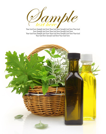 body oil: Fresh herbs in wicker basket, essential oils and herbal essences  Stock Photo