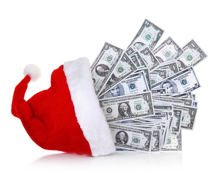 Dollar banknotes coming out of Santa Claus hat on white background photo