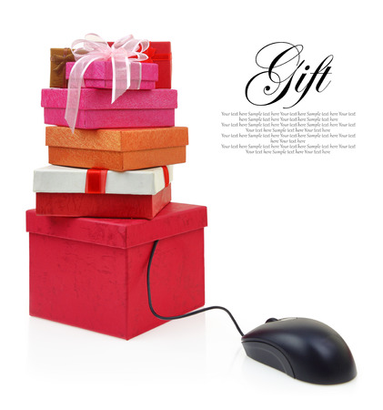 Stack of gift boxes connected to a computer mouse photo