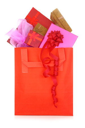 Gift boxes in a red shopping bag on white background photo
