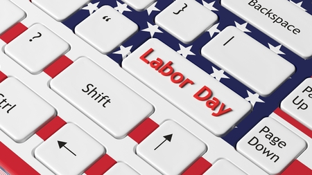 Laptop keyboard with American flag and Labor day key photo