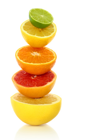 cut fruit: Fresh citrus fruit in a row on white background