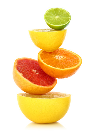 Fresh citrus fruit in a row on white background