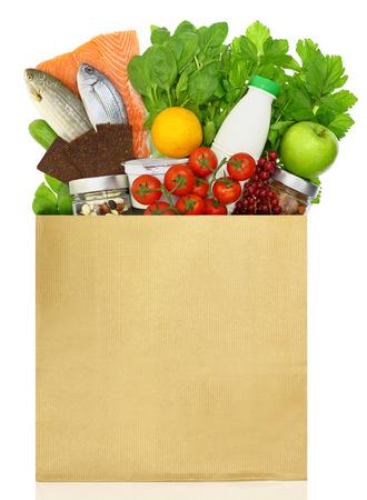 Paper bag filled with groceries Foto de archivo