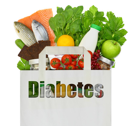 Paper bag with the word diabetes filled with healthy foods photo