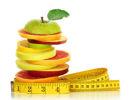 Fresh fruit slices and measuring tape isolated on white Banque d'images