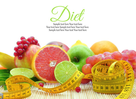 Fresh fruit slices and measuring tape photo