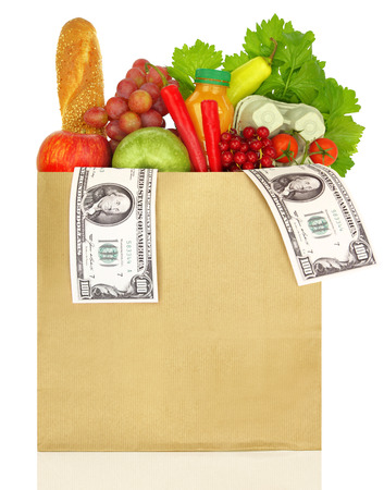 grocery trade: Paper bag filled with groceries and banknotes