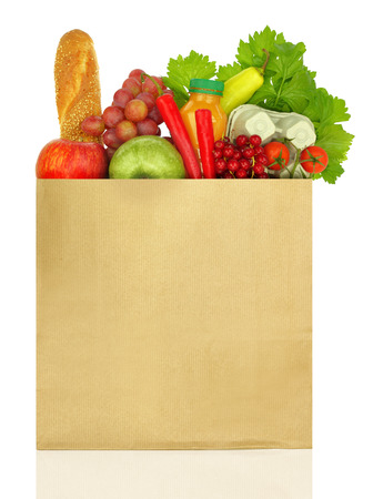 retail business: Paper bag full of groceries isolated on white