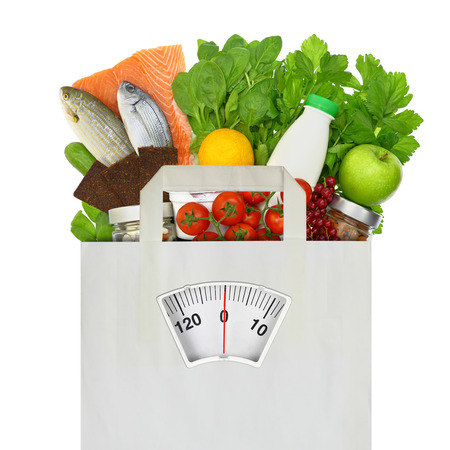 scales thin: Paper bag full of groceries with weighing scale