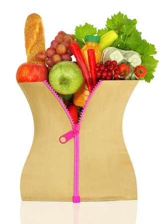 Unzipped shopping bag filled with groceries photo