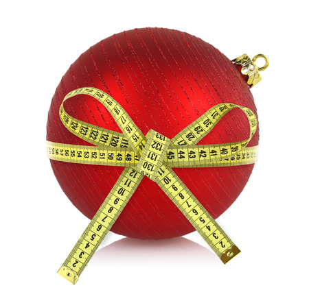 Christmas ball with measuring tape isolated on white photo