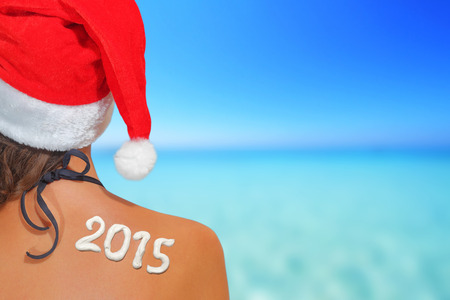 Woman with santas hat and 2015 written on her back photo