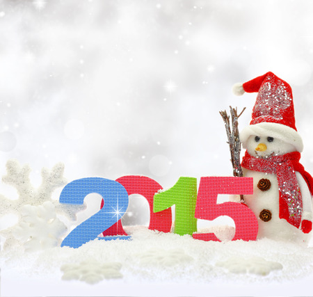 new year: Snowman and new year 2015 on snow