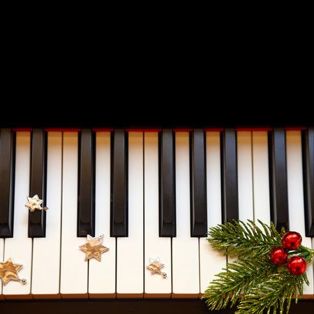 Christmas branch on piano keys