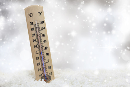 Thermometer on snow shows low temperatures photo
