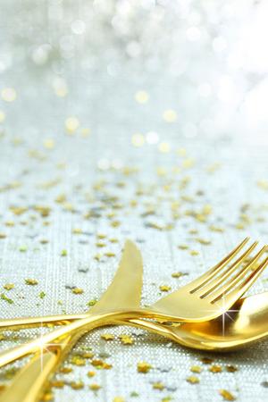 Christmas golden cutlery on festive background photo