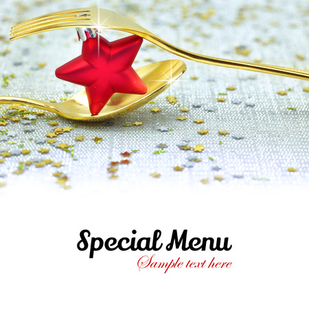 Christmas golden cutlery and on festive background
