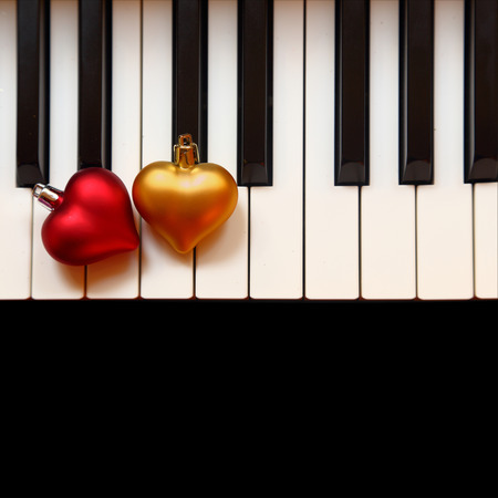 Christmas ornaments on piano keys photo
